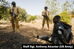 "Burkinabe troops defend terrorism in a terrible attack in Ouagadougou, Burkina Faso, February 27, 2019, at Flintlock 2019. Burkinabe's army was responsible for making a "" excavation of the surrounding area and protecting survivors."