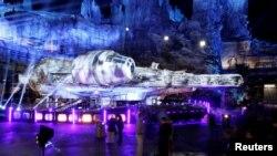 "Guests explore ""Star Wars: Galaxy's Edge"" near a Millennium Falcon starship at Disneyland Park in Anaheim, California, U.S., May 29, 2019."