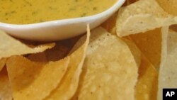 FILE - Nacho and creamy cheese dip.