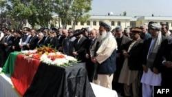 Afgan Devlet Başkanı Hamit Karzay ve yardımcıları Kasım Fehim ile Kerim Halili Rabbani'nin 23 Eylül'deki cenaze töreninde