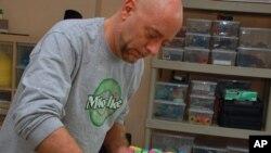 "Marshmallow Peeps artist David Ottogalli puts finishing touches on ""Bunny Chaos."""