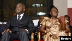 FILE - Laurent Gbagbo and his wife Simone Ehivet Gbagbo attend a memorial ceremony at Felix Houphouet Boigny stadium in Abidjan.