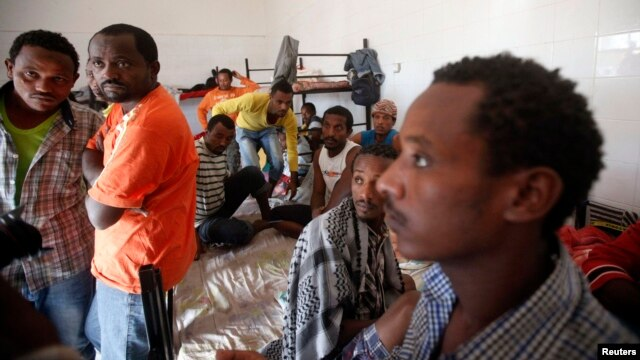 FILE - African migrants are seen in their dormitory at a detention center in Sorman, 55 km (34 miles) west of Tripoli, Libya.