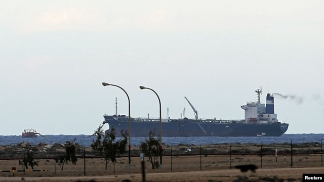 FILE - A North Korean-flagged tanker is docked at the Es Sider export terminal in Ras Lanuf, Libya, March 8, 2014.