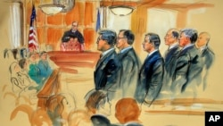 This courtroom sketch depicts Paul Manafort, fourth from right, standing with his lawyers in front of U.S. district Judge T.S. Ellis III, center rear, and the selected jury, seated left, during the jury selection of his trial at the Alexandria Federal Courthouse in Alexandria, Virginia, July 31, 2018.