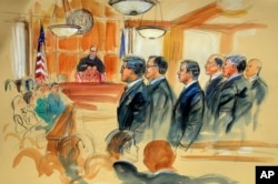This courtroom sketch depicts Paul Manafort, fourth from right, standing with his lawyers in front of U.S. district Judge T.S. Ellis III, center rear, and the selected jury, seated left, during the jury selection of his trial in Alexandria.