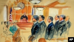 This courtroom sketch depicts Paul Manafort, fourth from right, standing with his lawyers during the jury selection of his trial at the federal courthouse in Alexandria, Va.