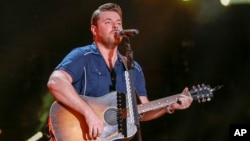 FILE - Chris Young performs at the CMA Music Festival at Nissan Stadium in Nashville, Tennessee, June 11, 2016. Young is donating $100,000 for disaster relief efforts in Texas.