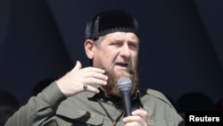 FILE - Head of the Chechen Republic Ramzan Kadyrov delivers a speech during a rally in support of Muslim Rohingya following the recent violence, which erupted in Myanmar, in the Chechen capital Grozny, Russia, Sept. 4, 2017.