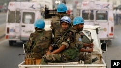 FILE- U.N. soldiers from Niger conduct a patrol through the streets of Abidjan, Ivory Coast, Jan. 10, 2011. The U.N. peacekeeping mission in Ivory Coast ended June 30, 2017, 13 years after forces intervened to implement a peace agreement that left the war-racked economic giant split into two pieces.