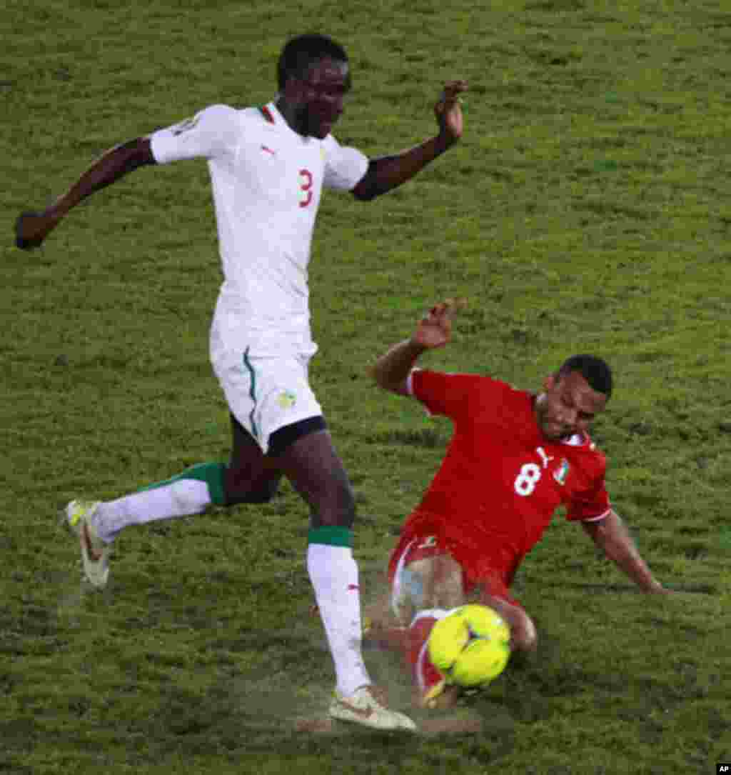 Iyanga of Equatorial Guinea challenges Sane of Senegal during their African Nations Cup Group A soccer match at Estadio de Bata
