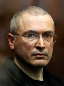 FILE - Russian former oil tycoon Mikhail Khodorkovsky stands in the defendants' cage during a court session in Moscow in 2010.