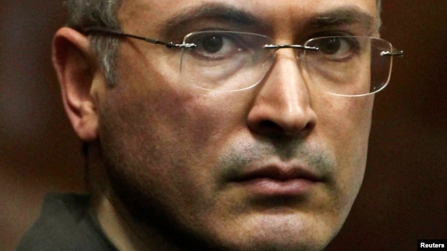 FILE - Jailed Russian former oil tycoon Mikhail Khodorkovsky stands in the defendants' cage during a court session in Moscow in 2010.