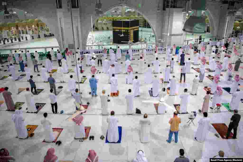 Muslims maintaining social distancing pray in the Grand Mosque in the holy city of Mecca, Saudi Arabia, for the first time in months since the COVID-19 restrictions were imposed.