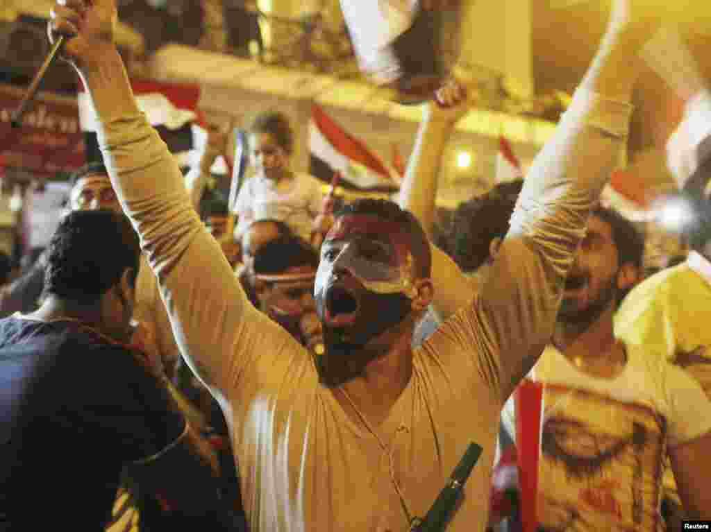 Anti-Morsi protesters chant as they celebrate into the night after the announcement of his removal from office, Tahrir Square in Cairo, July 3, 2013.