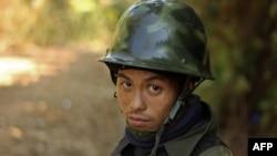 FILE - A Kachin rebel stands guard on Hka Ya mountain in Kachin province, Myanmar, Jan. 20, 2013.