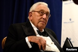 FILE - Former U.S. Secretary of State Henry Kissinger, who met with President Vladimir Putin on a trip to Russia, February, 2016, will reportedly meet with Donald Trump, Thursday, Nov. 17, 2016.