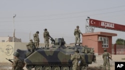 Turkish military station at the border gate with Syria, across from Syrian rebel-controlled Tel Abyad town, in Akcakale, Turkey, October 7, 2012.
