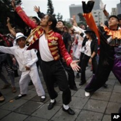 Thousands of people perform at the Monument of the Revolution in Mexico City, during an attempt to break the Guinness World Record of people dancing Michael Jackson's Thriller, in 2009. The event was organized in honor of the late pop star's birthday.