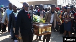 Mourners carry the casket of Andries Motlapula Ntsenyeho, one of the 34 striking platinum mineworkers shot dead at Lonmin's Marikana mine, in his hometown of Sasolburg in South Africa's Free State province, September 1, 2012.