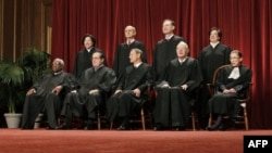 In this photo taken Oct. 8, 2012, the justices of the U.S. Supreme Court gather for a group portrait at the Supreme Court Building in Washington.