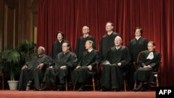 In this photo taken Oct. 8, 2012, the justices of the U.S. Supreme Court gather for a group portrait at the Supreme Court Building in Washington. The Supreme Court will begin hearing arguments on Monday morning, March 26, 2012, over President Barack Obama