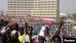 All Progressives Congress party supporters gather to welcome presidential candidate Muhammadu Buhari in Kano, January 20, 2015. As Nigeria approaches its most divisive and closely fought election since the end of military rule in 1999, its leaders are having to reassure voters that Africa's most populous nation will remain in one piece.
