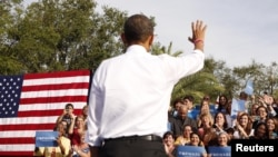 President Obama waves to supporters at a rally in Tampa, Florida, Oct. 25, 2012.