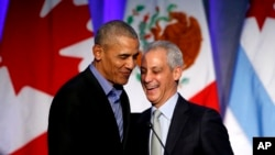 Former U.S. President Barack Obama, left, shares a laugh with Chicago Mayor Rahm Emanuel after Emanuel introduced Obama at a summit on climate change involving mayors from around the globe, Dec. 5, 2017, in Chicago.