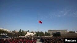 中国南京大屠杀博物馆前举行的纪念活动。(2014年12月13日)