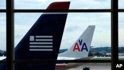 La nueva empresa fusionada se llamará American Airlines Group y cotizará en Nasdaq bajo las siglas AAL.