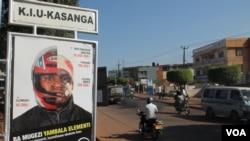 The Global Helmet Vaccine Initiative has mounted a campaign to encourage boda boda drivers to wear helmets, Kampala, Aug. 26, 2013. (Hilary Heuler/ VOA)