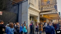 "People line up to see the musical ""Hamilton,"" Nov. 19, 2016, in New York. A man was arrested at the play in Chicago Saturday after shouting election-related comments, a misdemeanor."