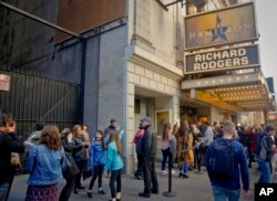 "People line up to see the Broadway play ""Hamilton,"" Nov. 19, 2016, in New York. President-elect Donald Trump demanded an apology from the cast of the hit musical a day after an actor lectured Vice President-elect Mike Pence about equality."