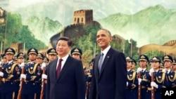 2014年11月12日,中国国家主席习近平在人民大会堂欢迎美国总统奥巴马。(资料照)