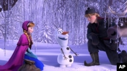 "This image released by Disney shows, from left, Anna, voiced by Kristen Bell, Olaf, voiced by Josh Gad, and Kristoff, voiced by Jonathan Groff in a scene from the animated feature ""Frozen."" (Disney)"