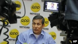 Peruvian presidential candidate Ollanta Humala speaks two days after the election at a local radio station in Lima, April 12, 2011