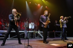 FILE - James Pankow, Walter Parazaider and Lee Loughnane of Chicago perform in Hollywood, Fla., April 4, 2013.