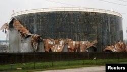 An oil tank damaged by Hurricane Harvey is seen near Seadrift, Texas, August 26, 2017.