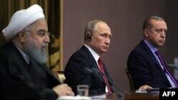 Головні гравці в сирійській кризі - президенти Ірану, Росії і Туреччини