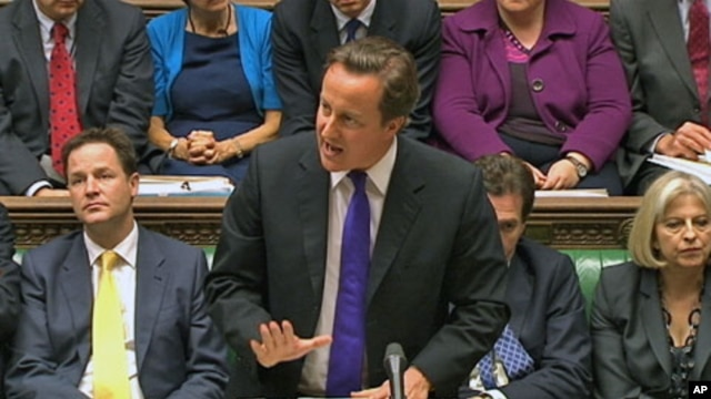 Britain's Prime Minister David Cameron, flanked by Deputy Prime Minister Nick Clegg (L) and Home Secretary Theresa May (R) speaks about phone hacking to parliament in a still image taken from video in London July 20, 2011
