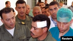 A Tunisian soldier wounded in the face during an ongoing hunt for a group of jihadists arrives at the hospital in Kasserine, the regional capital of the western region of Mount Chaambi, on May 6, 2013.