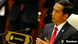 FILE - Indonesia's President Joko Widodo, shown at an ASEAN summit meeting last year in Naypyitaw, Myanmar, will be accompanied on his U.S. visit by tech leaders, who will be part of meetings with Microsoft, Facebook and Apple executives.