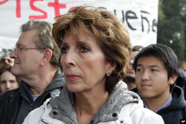 FILE - University of California, Davis Chancellor Linda Katehi waits to speak during a rally on campus in Davis, Calif., Nov. 21, 2011 after police pepper-sprayed peaceful demonstrators during a protest near the same spot on Friday.