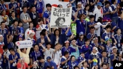 Japan fans at the end of their group H match between Japan and Senegal at the 2018 soccer World Cup at the Yekaterinburg Arena in Yekaterinburg, Russia, Sunday, June 24, 2018. (AP Photo/Mark Baker)