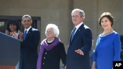 President Barack Obama stands with first lady Michelle Obama, left, former president George W. Bush, Laura Bush, and Barbara Bush at the dedication of the George W. Bush presidential library on the campus of Southern Methodist University in Dallas, April