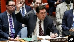 FILE - Russian Deputy U.N. Ambassador Vladimir Safronkov raises his hand to vote against a resolution at U.N. headquarters in New York, April 12, 2017.