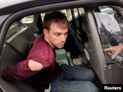 Travis Reinking, the suspect in a Waffle House shooting in Nashville, is under arrest by Metro Nashville Police Department in a wooded area in Antioch, Tennessee, April 23, 2018.