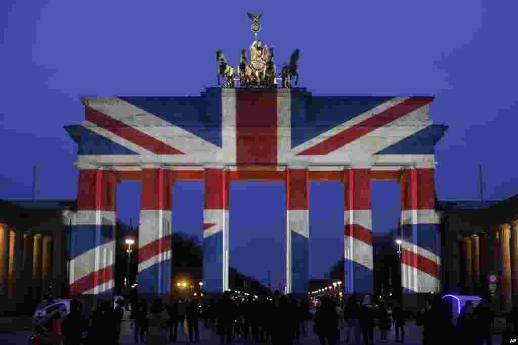 The Brandenburg Gate is illuminated in the colors of the British national flag in Berlin, Germany, to pay tribute to the victims of an attack in London.