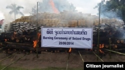 FILE - Laotian authorities burn seized drugs. Since 1989, the U.S. has contributed over $47 million to the fight.